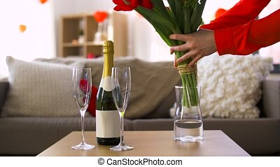 champagne and woman with flowers at valentines day -...