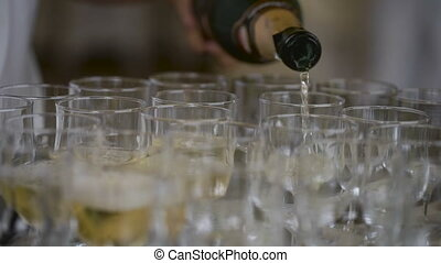Champagne at the feast spilled over the wine glasses, a familiar attribute of important events. A cold drink with bubbles, will cheer up the guests and please the wine lovers.