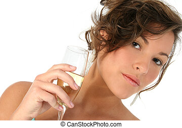 Beautiful young woman with glass of champagne. Shot in studio over white.