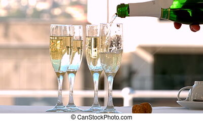 Champagne being poured into flutes