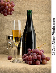 Champagne bottle, grape and bucket