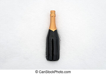 Champagne bottle in the snow. Green closed bottle without a...