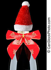 Champagne Bottle with Red Holiday Bow and Santa Hat on Black Background