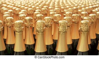 Champagne bottles on factory conveyor belt