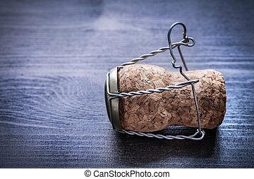 champagne corck on vintage wood board