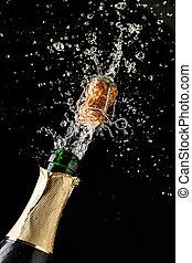 Champagne cork popping and splashing on black background....