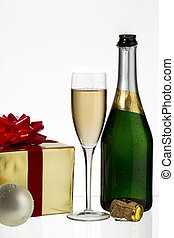 champagne flute and bottle with christmas gift - Champagne...