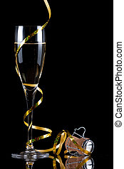 champagne flute with reflection isolated on black background