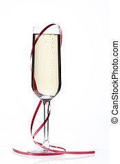 champagne flute surrounded by red streamer - Close-up shot...