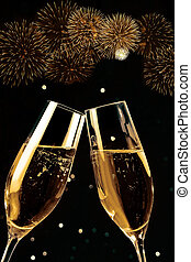 champagne flutes with golden bubbles make cheers with fireworks sparkle and black background