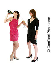 Two girls drinking champagne at a party.