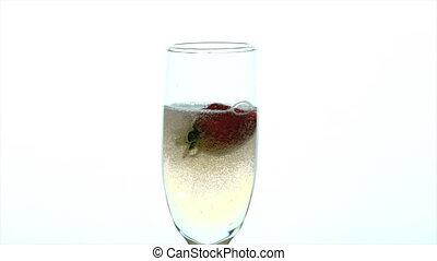 Champagne Glass Closeup - slow motion two strawberries are ...