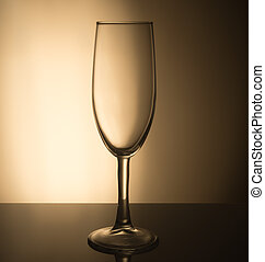 Champagne glass on a light brown background.