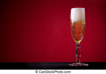 Champagne glass over red background