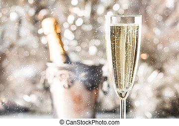 Champagne glass with a bottle