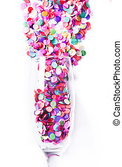 Champagne glass with confetti isolated on white background