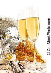 Champagne glass with gold party hats