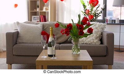 champagne, glasses and flowers at valentines day