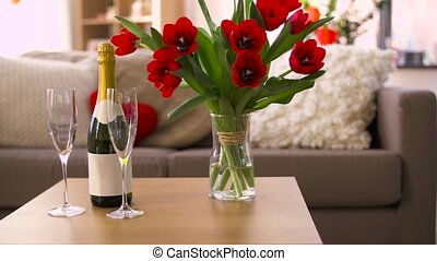 champagne, glasses and flowers at valentines day -...