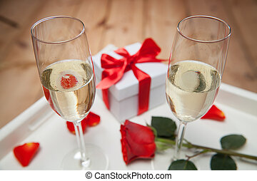 champagne glasses and red rose