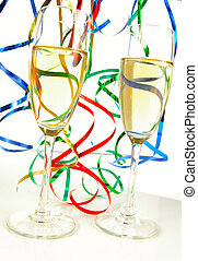 Champagne glasses and ribbons on white background