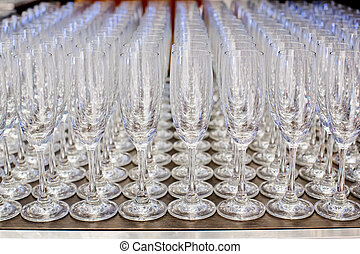 Champagne glasses in a row.