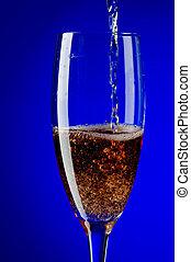 champagne glasses macro on blue