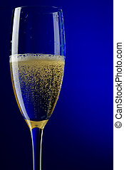 champagne glasses on blue macro