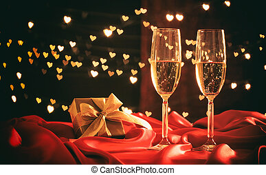 Champagne glasses on hearts bokeh background