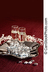 Champagne glasses on red