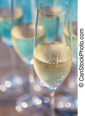 Champagne glasses on wooden background