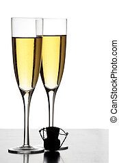 Champagne Glasses - Two champagne glasses and a cork in...