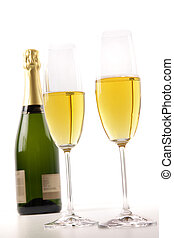 Champagne glasses with bottle on white