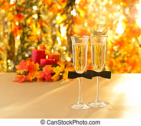 Champagne glasses with conceptual same sex decoration for gay men in front of autumn deco