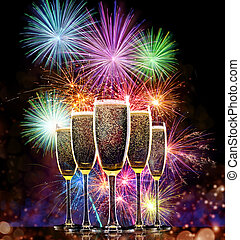 Champagne glasses with fireworks on background, New Year...