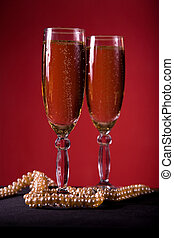 Champagne glasses with pearl necklace
