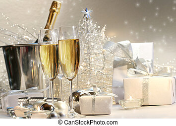 Champagne glasses with silver shimmering lit background