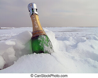 Champagne in a snow - Bottle of sparkling wine in a snow....