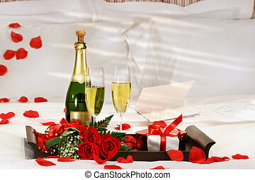 Champagne in bed to celebrate Valentine\'s Day