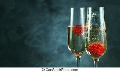 Champagne in flutes and fresh strawberries with bubble ...