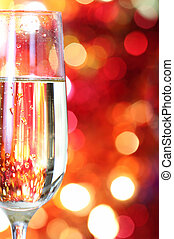 Champagne in glass at the christmas background
