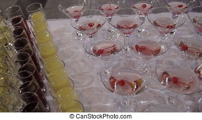 Champagne in glasses with fresh cherry on table and party...