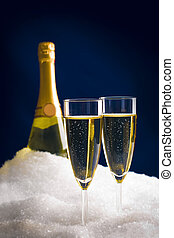 Champagne in snow - Vertical photo of two champagnes with ...