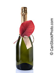 Champagne is decorated with a red leaf.