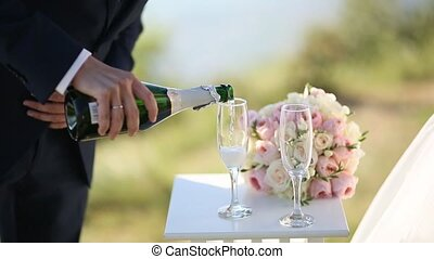 Champagne is poured into a glass
