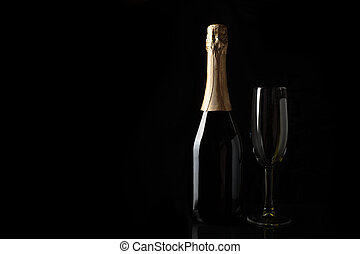 Champagne on a black background with space to copy.