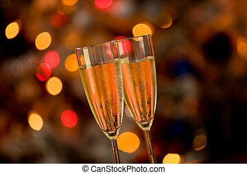 Champagne on Glass Table with Bokeh background - photo of...