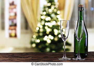 champagne on the background of the Christmas tree