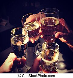 champagne party hands holding flute glasses four toast clinking