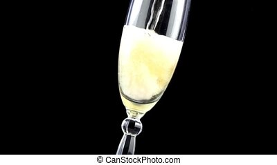 Champagne pouring into glass in slow motion